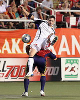 New England's Jay Heaps kicks the ball above Tino Nunez in the 1-2 RSL win at Rice Eccles Stadium in Salt Lake City, Utah on  June 21, 2008.