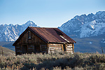 Idaho, Custer County,Stanley. The iconic cabin at Lower Stanley in front of the Sawtooth Range in spring.