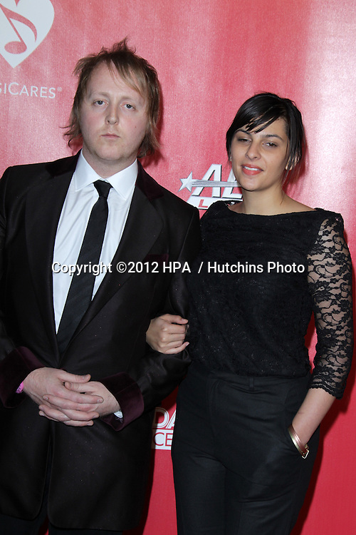 vLOS ANGELES - FEB 10:  James McCartney; Jade Nazareth arrives at the 2012 MusiCares Gala honoring Paul McCartney at LA Convention Center on February 10, 2012 in Los Angeles, CA