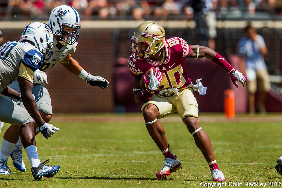 TALLAHASSEE, FLA 9/10/16-Florida State's Nyqwan Murray puts a move on two Charleston  Southern defenders during third quarter action Saturday at Doak Campbell Stadium in Tallahassee. <br /> COLIN HACKLEY PHOTO