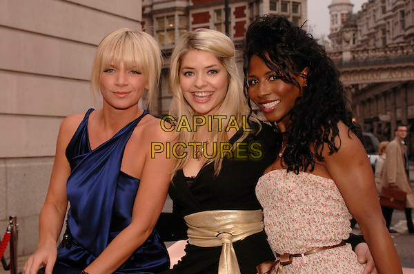 "ZOE BALL, HOLLY WILLOUGHBY & SINITTA.""Grease Is The Word"" photocall, Bloomsbury Ballroom, Victoria House, London, UK..March 28th, 2007.half length blue satin dress black pink floral print .CAP/FIN.©Steve Finn/Capital Pictures"