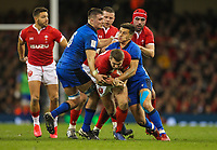 1st February 2020; Millennium Stadium, Cardiff, Glamorgan, Wales; International Rugby, Six Nations Rugby, Wales versus Italy; Dan Biggar of Wales is tackled by Jake Polledri and Tommaso Allan of Italy
