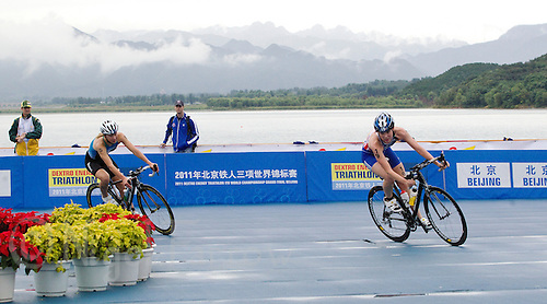 10 SEP 2011 - BEIJING, CHN - Britain's Lucy Hall (right) leads Monika Orazem of Slovenia during the Junior Women's 2011 ITU World Triathlon Championships (PHOTO (C) NIGEL FARROW)