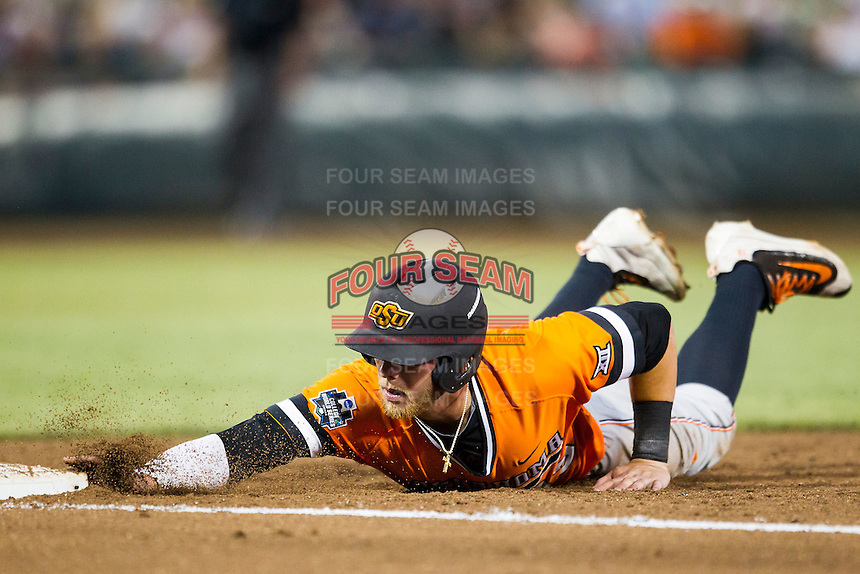 Oklahoma State Cowboys outfielder John Littell (13) dives back to first base against the Arizona Wildcats during Game 6 of the NCAA College World Series on June 20, 2016 at TD Ameritrade Park in Omaha, Nebraska. Oklahoma State defeated Arizona 1-0. (Andrew Woolley/Four Seam Images)