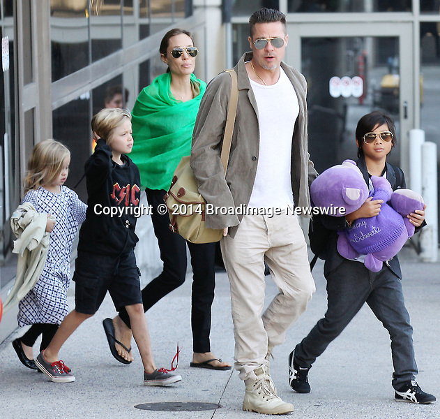 Pictured: Brad Pitt, Angelina Jolie, Shiloh Nouvel Jolie-Pitt, Maddox Chivan Jolie-Pitt, Pax Thien Jolie-Pitt, Knox Leon Jolie-Pitt, Zahara Marley Jolie-Pitt, Vivienne Marcheline Jolie-Pitt<br /> Mandatory Credit &copy; Ben Foster/Broadimage<br /> Brad Pitt, Angelina Jolie and family arriving at the Los Angeles International Airport<br /> <br /> 2/5/14, Los Angeles, California, United States of America<br /> <br /> Broadimage Newswire<br /> Los Angeles 1+  (310) 301-1027<br /> New York      1+  (646) 827-9134<br /> sales@broadimage.com<br /> http://www.broadimage.com<br /> <br /> <br /> Pictured: Brad Pitt, Angelina Jolie, Shiloh Nouvel Jolie-Pitt, Maddox Chivan Jolie-Pitt, Pax Thien Jolie-Pitt, Knox Leon Jolie-Pitt, Zahara Marley Jolie-Pitt, Vivienne Marcheline Jolie-Pitt<br /> Mandatory Credit &copy; Ben Foster/Broadimage<br /> Brad Pitt, Angelina Jolie and family arriving at the Los Angeles International Airport<br /> <br /> 2/5/14, Los Angeles, California, United States of America<br /> Reference: 020514_HDLA_BDG_005<br /> <br /> Broadimage Newswire<br /> Los Angeles 1+  (310) 301-1027<br /> New York      1+  (646) 827-9134<br /> sales@broadimage.com<br /> http://www.broadimage.com