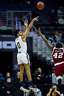 Washington, DC - MAR 7, 2018: La Salle Explorers guard Pookie Powell (0) hits a three pointer over Massachusetts Minutemen guard Rayshawn Miller (42) during game between La Salle and UMass during first round action of the Atlantic 10 Basketball Tournament at the Capital One Arena in Washington, DC. (Photo by Phil Peters/Media Images International)