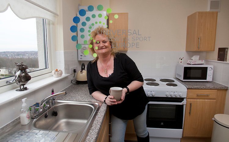 Jane  Cross in her new home  - Fleming Road development Cumbernauld.Picture: Maurice McDonald/Universal News And Sport (Scotland). 8 February 2012. www.unpixs.com.