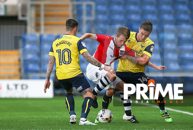 Josh Ruffels of Oxford United holds Max Smallcombe of Exeter City during the The Checkatrade Trophy match between Oxford United and Exeter City at the Kassam Stadium, Oxford, England on 30 August 2016. Photo by Andy Rowland / PRiME Media Images.