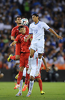 Washington, D.C.- May 29, 2014. Turkey defender Ishak Dogan heads the ball against Honduras midfielder Andy Najar  Turkey defeated Honduras 2-0 during an international friendly game at RFK Stadium.