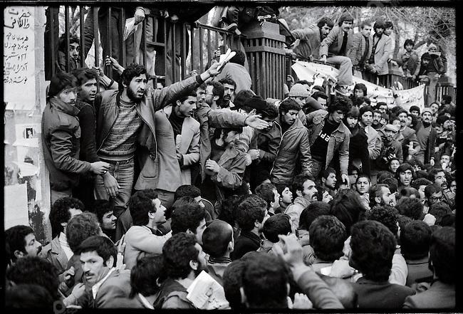Pro-Khomeini demonstrators at the university march down Shah Reza Boulevard. Tehran, January 27, 1979
