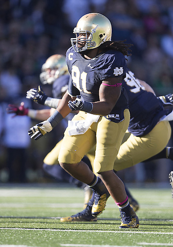 October 11, 2014:  Notre Dame defensive line Sheldon Day (91) rushes the passer during NCAA Football game action between the Notre Dame Fighting Irish and the North Carolina Tar Heels at Notre Dame Stadium in South Bend, Indiana. Notre Dame defeated North Carolina 50-43