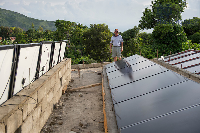 Aug. 11, 2015; Bill Jordan accesses the progress on the solar panel project at St. Gabriel School in Fontaine, Haiti. (Photo by Barbara Johnston/University of Notre Dame)