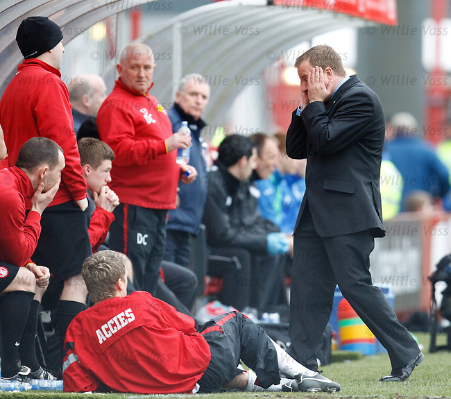 Hamilton manager Billy Reid turns away and holds his head in his hands