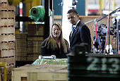 Bedford Heights, OH - January 16, 2009 -- United States President Elect Barack Obama (R) talks with shipping coordinator Sarah Keba (L) at Cardinal Fastener & Specialty Company, Inc., in Bedford Heights, Ohio, USA, 16 January 2009.  Obama met with workers at the plant, which manufactures parts used to construct wind turbines, to discuss an American Recovery and Reinvestment Plan, which would aim to create nearly half a million American jobs by investing in clean energy.  .Credit: David Maxwell - Pool via CNP