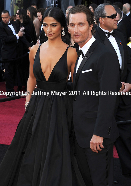HOLLYWOOD, CA - FEBRUARY 27: Camila Alves and Matthew McConaughey arrive at the 83rd Annual Academy Awards held at the Kodak Theatre on February 27, 2011 in Hollywood, California.