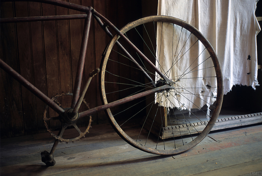 An old bicycle rests inside one of the old buildings of the Garnet Ghost Town, outside of Missoula, Montana.