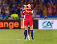 LYON,  - JULY 2: Sam Mewis #3 embraces Rachel Daly #17 during a game between England and USWNT at Stade de Lyon on July 2, 2019 in Lyon, France.