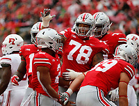Ohio State Buckeyes offensive lineman Demetrius Knox (78) celebrates a touchdown by running back J.K. Dobbins (2) during the second quarter of the NCAA football game at Ohio Stadium in Columbus on Sept. 8, 2018. [Adam Cairns / Dispatch]