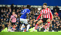 Everton's Idrissa Gueye under pressure from Lincoln City's Ellis Chapman<br /> <br /> Photographer Andrew Vaughan/CameraSport<br /> <br /> Emirates FA Cup Third Round - Everton v Lincoln City - Saturday 5th January 2019 - Goodison Park - Liverpool<br />  <br /> World Copyright &copy; 2019 CameraSport. All rights reserved. 43 Linden Ave. Countesthorpe. Leicester. England. LE8 5PG - Tel: +44 (0) 116 277 4147 - admin@camerasport.com - www.camerasport.com