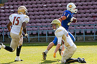 09 MAY 2010 - NORTHAMPTON, GBR - Birmingham Lions (blue) running back Andy Watson races past the Loughborough Aces (white and gold) defence to score in the British Universities American Football Championship Final (PHOTO (C) NIGEL FARROW)