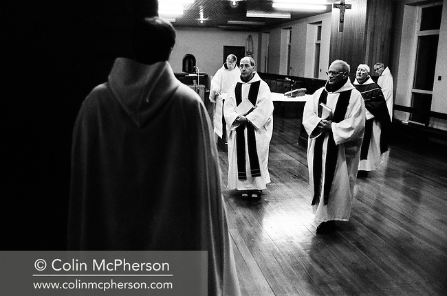 Monks at evening prayers in the chapel at Sancta Maria Abbey at Nunraw, East Lothian, home since 1946 to the Order of Cistercians of the Strict Observance. Around 15 monks were resident at Nunraw in 1996, undertaking a mixture of daily tasks and strict religious observance. The present purpose-built building dates from 1969 when the monks moved from the nearby Nunraw house.