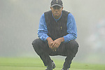 Ryder Cup 206 K Club, Straffan, Ireland..American Ryder Cup team player Tiger Woods on the edge of the 12th green in the pouring rain during the morning fourballs session of the second day of the 2006 Ryder Cup at the K Club in Straffan, Co Kildare, in the Republic of Ireland, 23 September 2006...Photo: Eoin Clarke/ Newsfile.