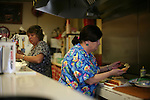 Mary Lou Campbell, right, works during the lunch rush at The White Flash in Jackson, Ky., on Thursday, Oct. 13, 2011. Campbell works at and owns the diner, helped by friends that she has known for years. Photo by Tessa Lighty