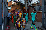 The teams making their way onto the pitch before Bradford City (in claret and yellow) played Carlisle United in a Skybet League 2 fixture at Valley Parade. The home team were looking to bounce back after being relegated during a disastrous 2018-19 season on and off the pitch. Bradford won the match 3-1, watched by a crowd of 14, 217.