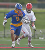 Ryan Forcino #9 of West Islip, left, and Mike Gomez #29 of of Half Hollow Hills East battle fora loose ball during a Suffolk County varsity boys lacrosse game at Half Hollow Hills High School East on Tuesday, May 9, 2017. Hills East rallied from an early 6-2 deficit to win 14-10.