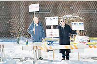Lloyd Gatling, (left) of Suffolk, Virginia, brother-in-law of former Virginia governor and Republican presidential candidate Jim Gilmore holds campaign signs for the candidate outside the polling location for Manchester Ward 2 at Hillside Middle School in Manchester, New Hampshire, on the day of primary voting, Feb. 9, 2016. Also pictured is Jack Cohen, of Manchester, New Hampshire, a volunteer with the Trump campaign. Gilmore finished in last place among major Republican candidates still in the race with a total of 150 votes.