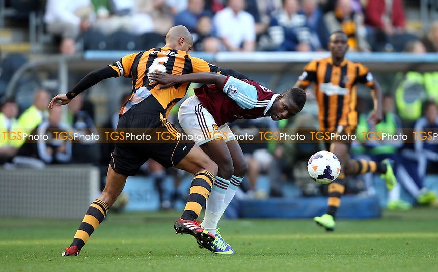 Modibo Maiga of West Ham and Curtis Davies of Hull - Hull City vs West Ham Utd, Barclays Premier League at the KC Stadium, Hull - 28/09/13 - MANDATORY CREDIT: Rob Newell/TGSPHOTO - Self billing applies where appropriate - 0845 094 6026 - contact@tgsphoto.co.uk - NO UNPAID USE