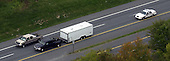 """Frederick, MD - October 24, 2002 -- A white truck containing the vehicle where the """"Beltway Sniper"""" was found sleeping at a rest stop along Route 70 returns its cargo to the Police Warehouse in Rockville, MD.<br /> Credit: Ron Sachs / CNP<br /> (RESTRICTION: NO New York or New Jersey Newspapers or newspapers within a 75 mile radius of New York City)"""