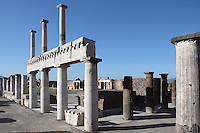 Colonnade around the Forum, Pompeii, 2nd century BC and of two-storey colonnaded porticoes with Doric columns which are lit by the strong light of a summer afternoon