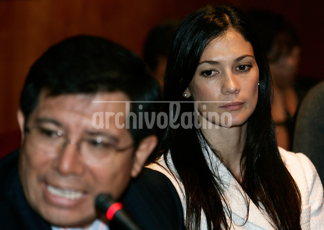 Fiorella Fare, right, wife of FIFA agent Carlos Delgado, speaks during a session at Peruvian Congress in Lima, Peru, Monday, March 23, 2009. Fare denounces her husband for fraud to differents soccer players. Peruvian striker Claudio Pizarro, who is on loan to Werder Bremen from Chelsea, also has been implicated in the fraud investigation targeting his agent Carlos Delgado. Pizarro allegedly has a stake in Delgado's company Image. At left is Roger John, Fiorella Fare's lawyer. Archivolatino/Karel Navarro
