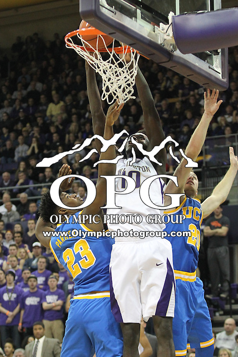 JAN 1, 2016:  Washington's #10 Malik Dime slams the ball down for a dunk against UCLA.  Washington defeated #25 ranked UCLA 96-93 in double overtime at Alaska Airlines Arena in Seattle, WA.