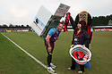 Histon fan and ex-para Pete Digby who is running the London Marathon with an 80lb washing machine strapped to his back with the laundry lady and the Histon mascot before the Blue Square Bet Premier match between Histon and AFC Wimbledon at the Glass World Stadium, Histon on 16th April, 2011.© Kevin Coleman 2011.