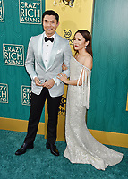 HOLLYWOOD, CA - AUGUST 07: Henry Golding (L) and Constance Wu arrive at the Warner Bros. Pictures' 'Crazy Rich Asians' premiere at the TCL Chinese Theatre IMAX on August 7, 2018 in Hollywood, California.<br /> CAP/ROT/TM<br /> &copy;TM/ROT/Capital Pictures