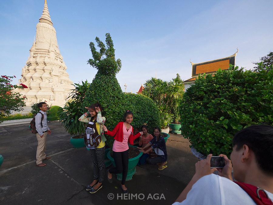 Phnom Penh, Cambodia. Royal Palace. Silver Pagoda Compound. Tourists making souvenir photos in front of Stupa of King Ang Duong.
