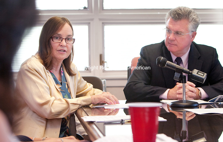 WATERBURY, CT. 23 June 2010-062310SV03--From left, House Majority Leader Denise Merrill speaks to business leaders as State House Speaker Christopher G. Donovan listens during a legislative/business community gathering at Platt Brothers in Waterbury Wednesday. The event was sponsored by the Waterbury Regional Chamber.<br /> Steven Valenti Republican-American