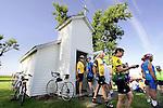 Riders visit the Bethlehem Chapel in Bethlehem Thursday on RAGBRAI XXXVII.  The tiny roadside chapel has room to seat 16.