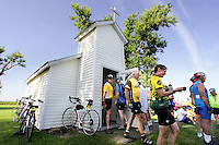 Riders visit the Bethlehem Chapel in Bethlehem Thursday on RAGBRAI XXXVII.  The tiny roadside chapel has room to seat 16.