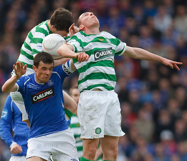 Barry Ferguson squashed in a challenge with Scott Brown and Gary Caldwell