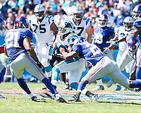 The Carolina Panthers played the New York Giants at Bank of America Stadium in Charlotte, NC.  The Panthers won 38-0 for their first victory of the season.  The Giants dropped to 0-3.  Carolina Panthers wide receiver Ted Ginn (19) is tackled by New York Giants cornerback Prince Amukamara (20)