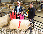 Charles Walsh form Cahersiveen after his Ram won the Best Wool at the Kerry Blackface Sheep Breeders Association show at the Mid-Kerry Co-op livestock Mart in Milltown  on Saturday, Pictured here l-r; Shauna, James, Sofia,and Charles Walsh.