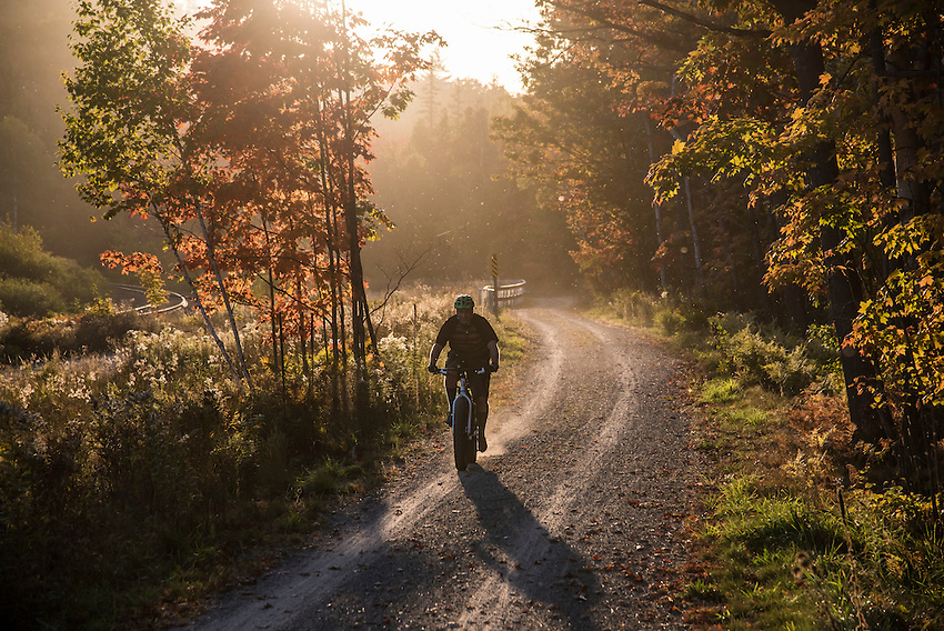 A mountain biker on the Iron Ore Heritage Trail that connects communities in Marquette County, Michigan.