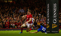 1st February 2020; Millennium Stadium, Cardiff, Glamorgan, Wales; International Rugby, Six Nations Rugby, Wales versus Italy; Nick Tompkins of Wales evades the attempted tackle by Matteo Minozzi of Italy to score a try on his debut and make the score 26-0