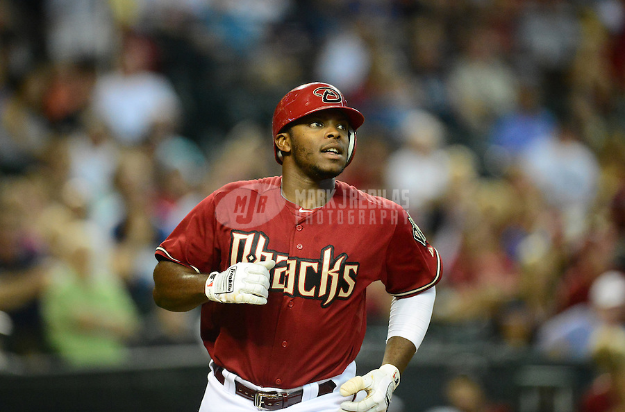 Apr. 22, 2012; Phoenix, AZ, USA; Arizona Diamondbacks batter Justin Upton heads to first base after being hit in the hand by a pitch in the fifth inning against the Atlanta Braves at Chase Field. Mandatory Credit: Mark J. Rebilas-