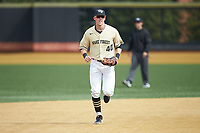 Wake Forest Demon Deacons right fielder Cole McNamee (40) jogs off the field between innings of the game against the Notre Dame Fighting Irish at David F. Couch Ballpark on March 10, 2019 in  Winston-Salem, North Carolina. The Demon Deacons defeated the Fighting Irish 7-4 in game one of a double-header.  (Brian Westerholt/Four Seam Images)