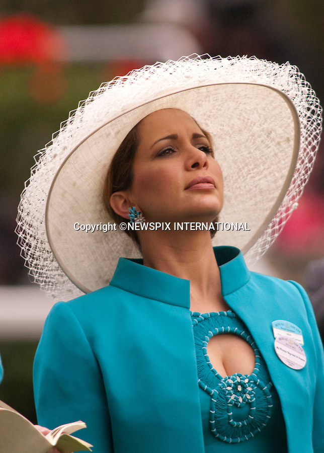"""Princess Haya bint Al Hussein and Sheikh Mohammed bin Rashid AL Maktoum support their horse as they attend the Ladies Day of racing at the Royal Ascot Meeting, Ascot_18/06/2009.Mandatory Photo Credit: ©Dias/Newspix International..**ALL FEES PAYABLE TO: """"NEWSPIX INTERNATIONAL""""**..PHOTO CREDIT MANDATORY!!: NEWSPIX INTERNATIONAL(Failure to credit will incur a surcharge of 100% of reproduction fees)..IMMEDIATE CONFIRMATION OF USAGE REQUIRED:.Newspix International, 31 Chinnery Hill, Bishop's Stortford, ENGLAND CM23 3PS.Tel:+441279 324672  ; Fax: +441279656877.Mobile:  0777568 1153.e-mail: info@newspixinternational.co.uk"""