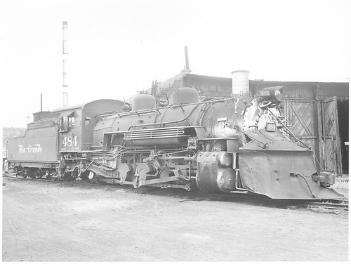3/4 engineer side view of K-36 #484 with plow at Durango.  Roundhouse is in background.<br /> D&amp;RGW  Durango, CO  Taken by Payne, Andy M. - 7/21/1964